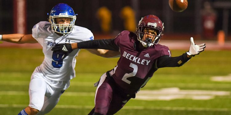 File Photo - Beckley's Keynan Cooks extends for a pass during a loss to Princeton on Oct. 1 in Beckley (Greg Barnett)
