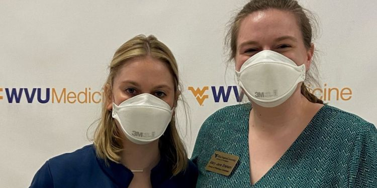 Two West Virginia University School of Pharmacy students, Kara Howard, left, and Mary Jane Braham, were among the volunteers for COVID-19 vaccination clinics in Spring 2021. (WVU Photo)