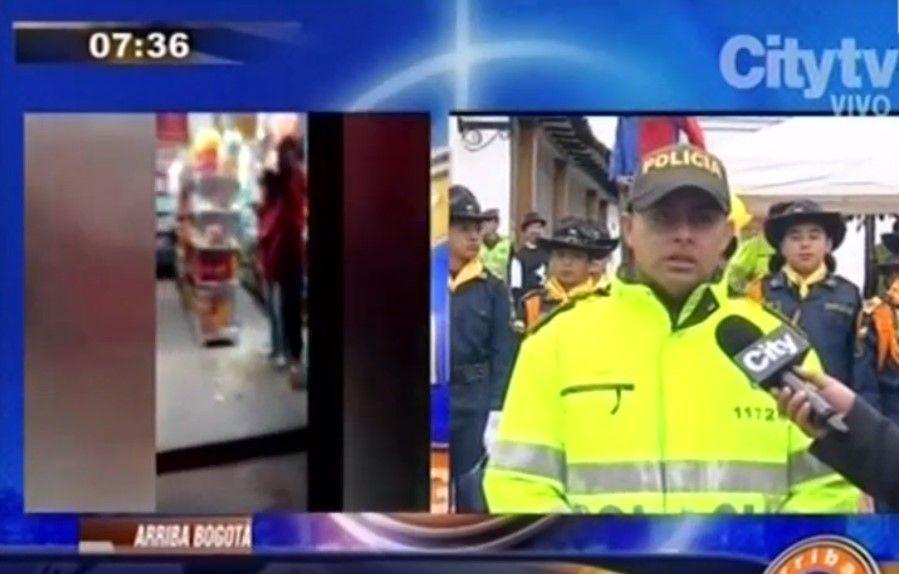 Policía que rescató a  mujer rehén de un indigente en Bogotá. Foto de CityTv