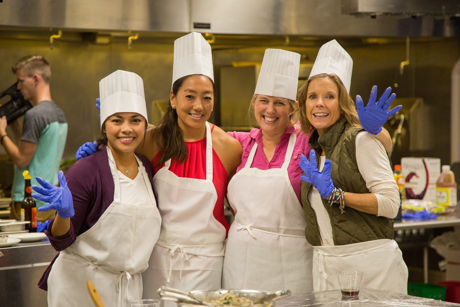Ladies in chef hats and aprons