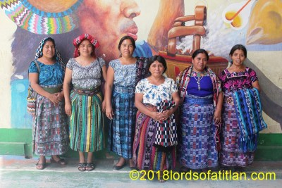 Group of women with public art of San Juan la Laguna