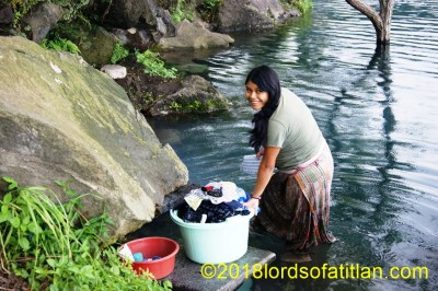Nancy washing in Las Conchitas, San Lucas Tolimán, however only two weeks before giving birth.