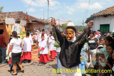 A number of odd personages accompany the procession of  Corpus Cristi (Body of Christ) in San Bernardino. For example: the iguana salesman.