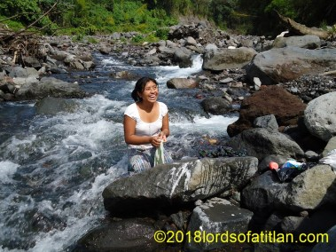 Woman from Colonia Pampojilá washing in river, but in La Nueva Providencia, San Lucas Tolimán