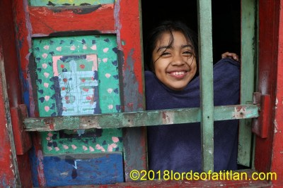 Girl in window in the procession route of San Sebastián Retalhuleu.