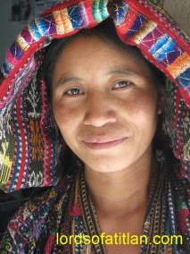 Woman from Xejuyú, Concepción with rainbow reflecting on her face and tzute.