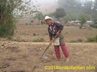 Casimiro Solís of  Chui Solís planting corn.