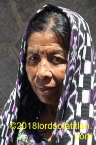 Woman walking in procession in San Pedro la Laguna