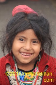 This flower girl from Las Majadas is desperately poor but always smiling and adorable.