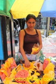 Norma from San Sebastián sells fruit in Xela. Meanwhile, her sister Noemi sells in San Pedro la Laguna..