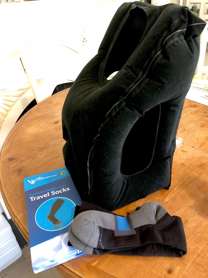 Have you ever tried travel/compression socks? Or one of these face forward travel pillows?