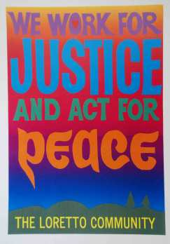 """Colorful Strobridge banner reading """"We Work for Justice and Act for Peace."""""""