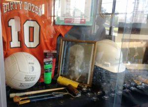 An awards case spotlights Sandy Ardoyno's years of service at McGill-Toolen High School. (Photo courtesy of Mary Peter Bruce)