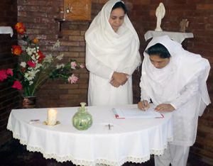 From left, Nasreen Daniel receives the vow renewal of Samina Iqbal. (Photo courtesy of Pakistan Sisters)