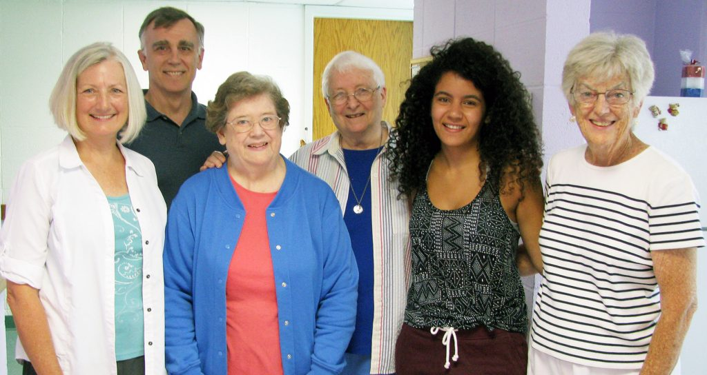 From left are Penny Allen, Davis Allen, Rosemary Sullivan OP, Nancy Wittwer, Wafaa Abu Elula and Sheila Brennan OP. Penny and Davis, members of Emmanuel Episcopal Church in Webster Groves, met Wafaa in Chicago. They drove her July 27 to the St. Louis Loretto Center, where Wafaa now resides while she attends Webster University.  Here they are on Wafaa's welcoming tour of the Loretto Center. (Photo by Jean M. Schildz)