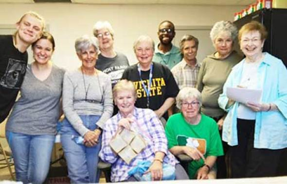 Vivian Doremus, at far right, and her sister Judith Powers, holding a bag of sandwiches, gather with volunteers and the site coordinator at Casa Oscar Romero in El Paso, Texas. (Photo courtesy of Vivian Doremus)
