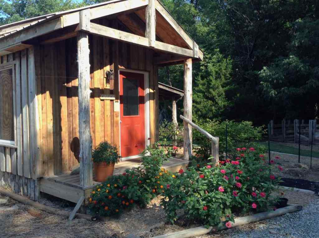 Sunlight shines on the front porch of the office cabin at Cedars of Peace.
