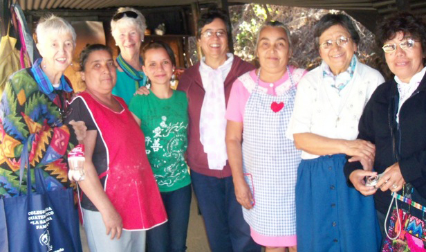 Two Sisters of Loretto pose with six Holy Family Sisters