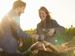 Young couple enjoys a picnic in the country after ketamine wannabe drug treatment for treatment resistant mood disorders.