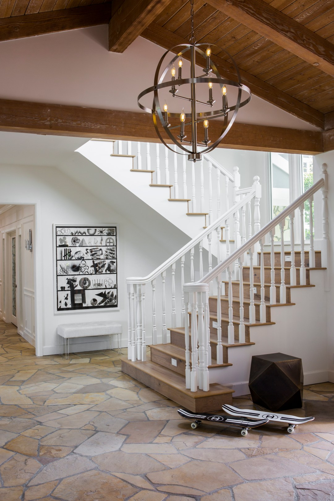 The entryway chandeliers are also from Lamps Plus: The Hudson Valley manufactured Bari chandelier in polished nickel was the perfect fixture to add some glamour to the California Ranch home.