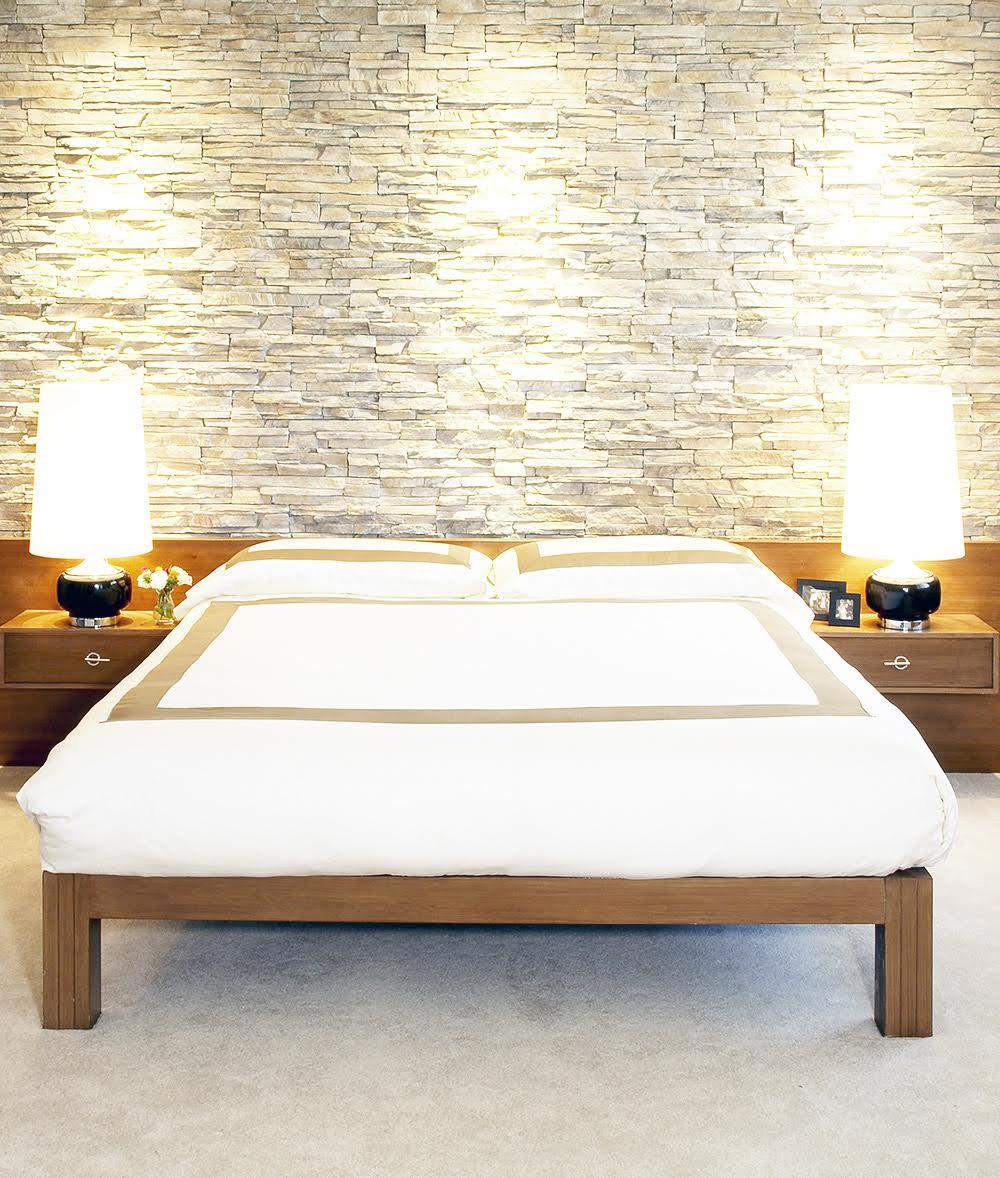 Stone veneer wall feature in Lake Tahoe mid century modern bedroom by interior designer Lori Dennis won green interior design award