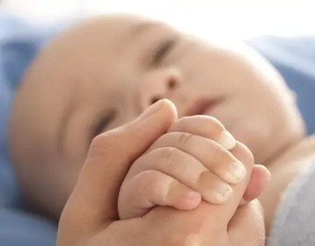 reaching in crib