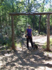 Kuma hikes around Bastrop Lake in Texas