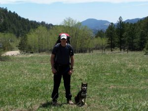 Kuma and his dad with mountain views
