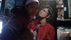 Mitzi Macias with one of her acrylic paintings of Japanese Popstar 'Gackt Camui'.