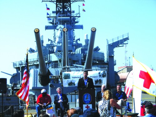 The Battleship USS Iowa, located in San Pedro, was the setting this past Wednesday to host the official recognition of the Veterans History Project  for the Los Angeles County Chapter. American Red Cross CEO Jarrett Barrios (center) addresses the veterans. Seated (l-r) Kevin Shelby, Cold War Navy Veteran, Bob Patrick Director Veterans History Project, Michael Jordan, Vice President Humanitarian Service and Mike Getscher, Executive Vice President Pacific Battleship Center. Photo by Tammye McDuff
