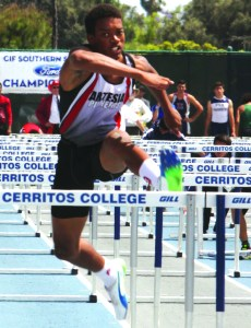 Artesia senior Jaydon Logan heads for the stretch run in the 110 meter high hurdles in last Saturday's California Interscholastic Federation-Southern Section Track and Field Divisional Finals. Logan finished in fifth place in Division III with a time of 14.81. PHOTO BY ARMANDO VARGAS