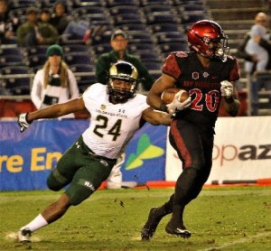 Ex-Norwalk High star Rashaad Penny gets away from Bryce Peters on one of his career-high seven kickoff returns in San Diego State University's home finale against Colorado State University on Nov. 26. Penny had 113 return yards against the Rams, which is a season-high and second most in his three years at SDSU. PHOTO BY ARMANDO VARGAS, Contributing Photographer
