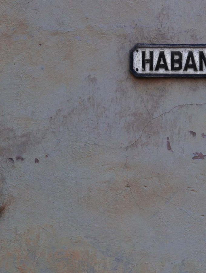 Yellow and Beige Textured wall with Habana street sign