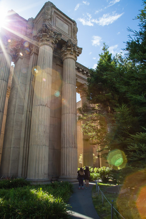 Colums of The Palace of Fine Arts and two people looking up | LOST NOT FOUND | Place by Place an Ongoing Guide to SF The Palace of Fine Arts