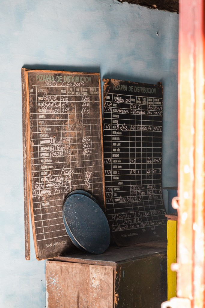 Chalkboards with writing on them indicating what rations are available in Havana Cuba | LOST NOT FOUND| La Habana | Cuba | Havana | Street Photography