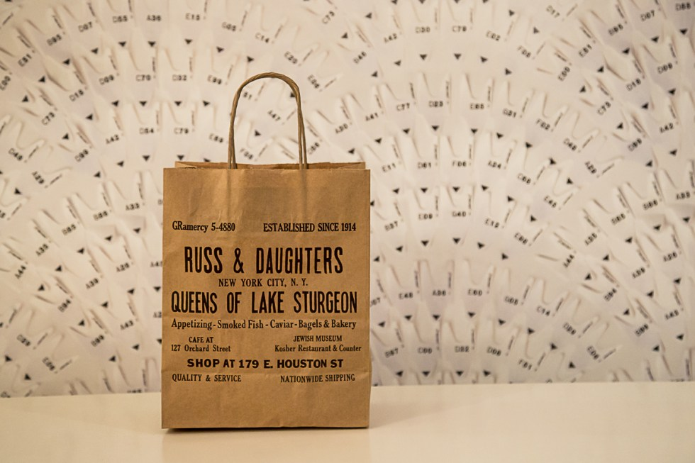 Russ and Daughters Bag in front of wall | LOST NOT FOUND | NYC Restaurant Guide
