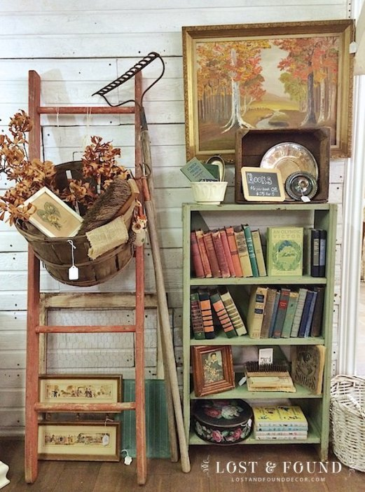fall antique booth display with old ladder