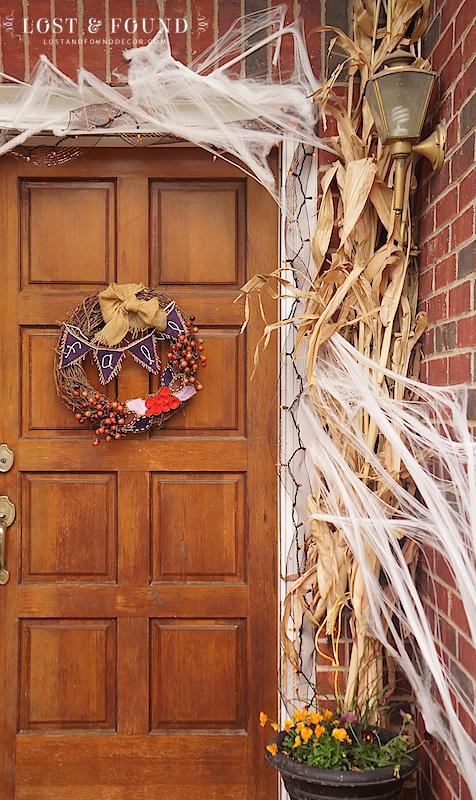 Front door Halloween decorations with corn husks