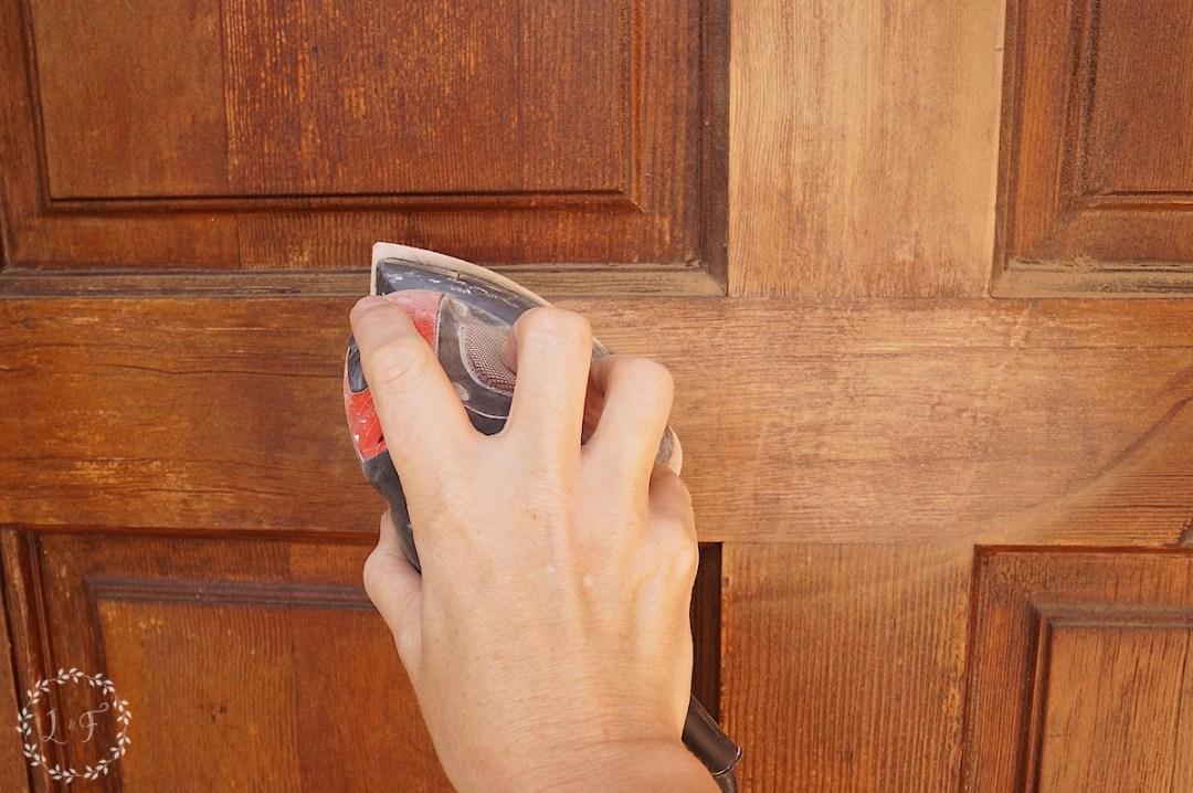 sanding the door