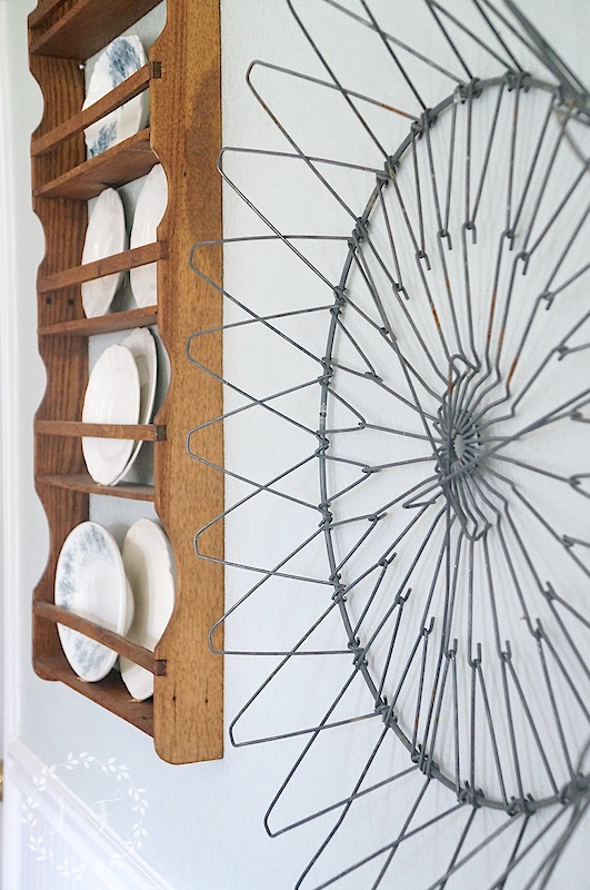 Vintage folding metal laundry basket as awesome wall art