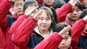 Chinese students salute during a flag-raising ceremony at a junior high school in Shanghai. Photo from NPR