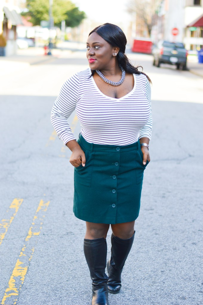 simple button down skirt with black boots and black and white stripped long-sleeve shirt