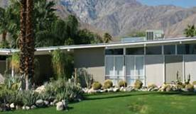 Original Condition Mid Century Modern home with slant roof, clean paint treatment, clear clerestories and attractive planting.