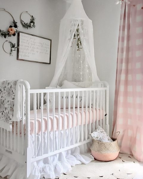 pink and white crib