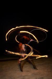 Fire hoop performer