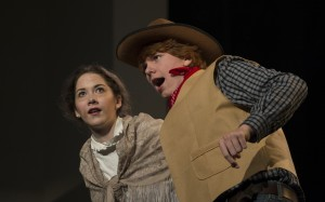 """November 30, 2015: Maria Brock playing Aunt Eller and Brody Brown playing Curly in Loudoun County High School Drama & Choral Department's dress rehearsal of Rodgers & Hammerstein's """"Oklahoma"""". The Play opens on December 3rd and runs for three nights. (Photo by Douglas Graham/Loudoun Now)"""