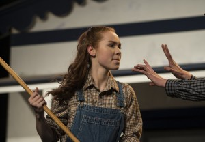 """Shannon Connors, who plays Laurey and Brody Brown playing Curly in Loudoun County High School Drama & Choral Department's dress rehearsal of Rodgers & Hammerstein's """"Oklahoma"""". The Play opens on December 3rd and runs for three nights. (Photo by Douglas Graham/Loudoun Now)"""