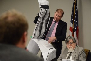 Board of Zoning Appeals member Rory Clark examines plans for The Young Group's self-storage facility at Davis Church. (Renss Greene/Loudoun Now)