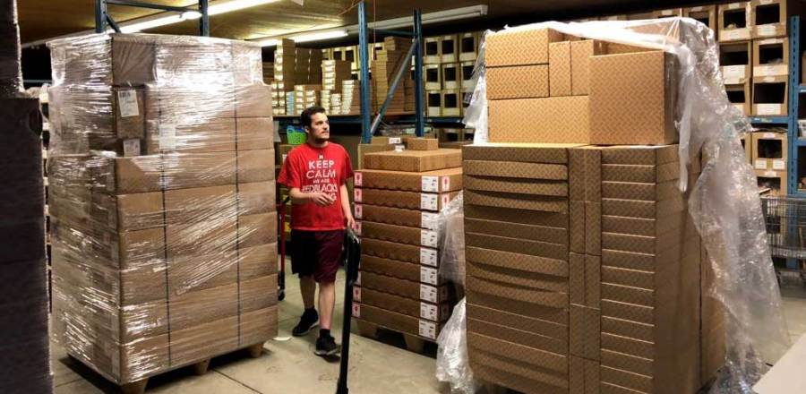 Andrew receiving new shipment at Louet North America