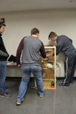 A group of high school students compete in the Rube Goldberg competition.